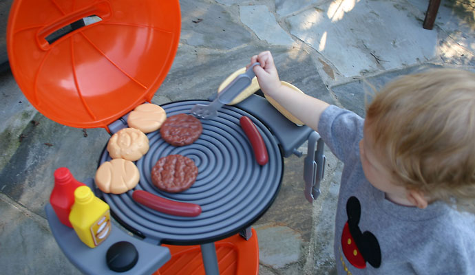 That Poore Baby Playing with the Little Tikes Sizzle n Serve Grill